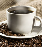 Smoking hot cup of coffee Stock Images