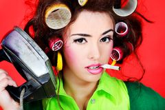Smoking housewife Stock Images