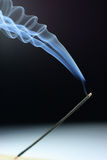 Smoking incense. Swirl of Smoking incense on a black back ground stock images