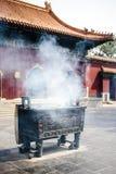 Smoking incense sticks in Lama temple, Beijing, China Royalty Free Stock Photo