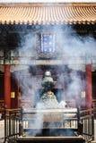 Smoking incense sticks in Lama temple, Beijing, China Stock Photo