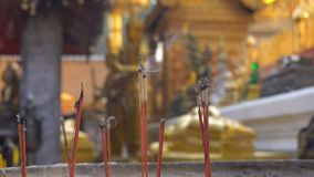 Smoking Incense Sticks for Praying Buddha gods to show respect. a lot of smoke is Flowing. 4k UHD stock video footage