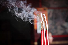 Smoking incense sticks Stock Image