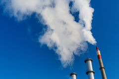Smoking industrial chimney Stock Photos