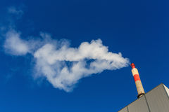 Smoking industrial chimney Royalty Free Stock Images