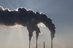 Smoking industrial chimneys. Combined heat and power Stock Photo