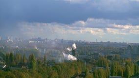 Smoking industrial chimneys polluting the air