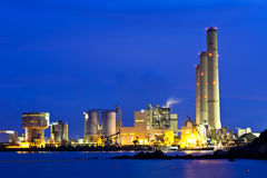 Smoking industrial power plant at night Royalty Free Stock Photo