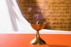 Smoking insence cone. Smoking incense cone in the copper holder Royalty Free Stock Photography