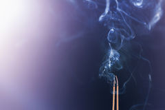 Smoking joss stick Royalty Free Stock Photography