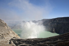 Smoking Kawa Ijen. Colorful crater lake at the Kawa Ijen in Java, Indonesia Stock Images