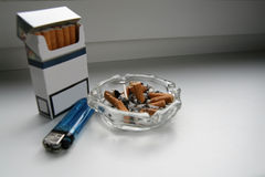 Smoking kills. Cigarette pack, cigarette-lighter and ashtray with cigarette butts... or stud to heart Stock Images