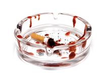 Smoking kills. Blooded cigarette in ash-tray on white background royalty free stock images