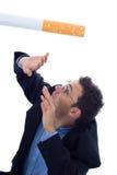 Smoking kills. Falling cigarette illustrating how smoking kills Stock Photos