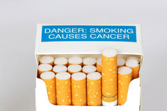 Smoking kills. A packet of cigarettes with a warning it causes cancer Stock Photos