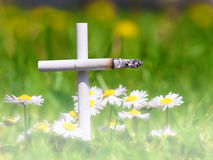 Smoking kills. Cross of cigarettes in the fog, the concept of Royalty Free Stock Photo