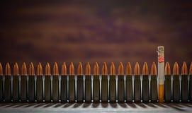 Smoking kills. Conceptual image. Smoking kills. One cigarette among the bullets. Conceptual image Stock Photography