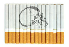 Smoking kills. Conceptual image with skull on cigarettes Royalty Free Stock Photo