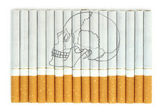 Smoking kills. Conceptual image with skull on cigarettes Stock Photos
