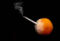 Smoking kills image of rotten orange on a black background Royalty Free Stock Photos
