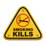 Smoking kills - yellow sign Royalty Free Stock Photo