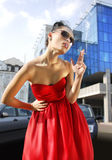Smoking lady in red dress Stock Photo
