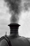 Smoking locomotive chimney Stock Photo