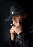 Smoking mafia guy Stock Photo