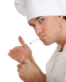Smoking male cook Royalty Free Stock Images