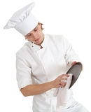 Smoking male cook with brown plate Royalty Free Stock Image