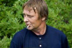 The smoking man Stock Photography
