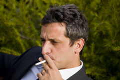 Smoking man Stock Images