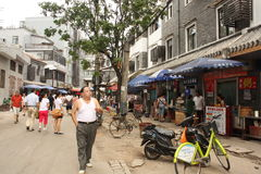 Smoking man at Chinese Food street in Wuhan, China Stock Photo