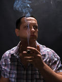 Smoking man with cigar Royalty Free Stock Images
