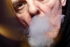 Smoking man. Close up portrait of a smoking man Royalty Free Stock Image