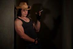 Smoking man in cowboy hat Royalty Free Stock Photos