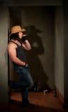 Smoking man in cowboy hat Stock Images