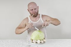 Smoking man eat cabbage and mushrooms Stock Photos
