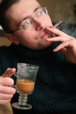 Smoking man with glass Royalty Free Stock Photo