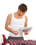 Smoking man ironing clothes Stock Photography
