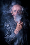 Smoking man portrait in low key Stock Photos