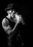 Smoking man portrait in monochrome Royalty Free Stock Image