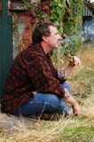 Smoking man profile Stock Photos