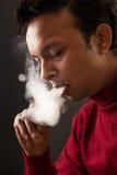 Smoking man using electronic cigarette Royalty Free Stock Photos