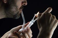 Smoking marijuana Stock Photo