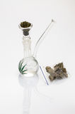 Smoking marijuana. Beautiful glass pipe with marijuana on white background, marijuana symbol stock photography
