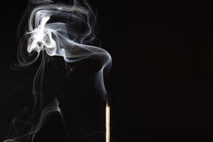 Smoking match. A photo of a match with its stunning twirls Royalty Free Stock Image