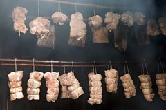 Smoking meat in the smokehouse Stock Images