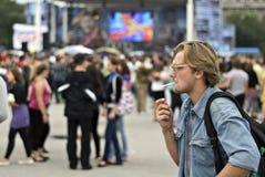 The smoking men in crowd Stock Image