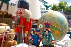 Smoking men, nutcracker and the globe Stock Image